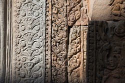 Wall sculpture at Angkor Wat was carved by ancient Khmer on stone in many decades ago.