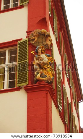 Wall Sculpture of Madonna with Child fighting Devil, Heidelberg
