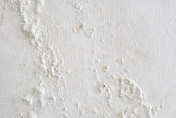 Wall showing peeling and bubbling paint due to water leak behind wall.
