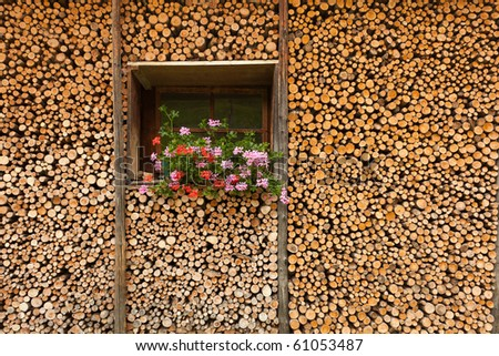 Wall stacked with wood blocks and a window
