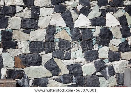 Wall stone texture of an old Sevanavank church in Sevan, Armenia #663870301