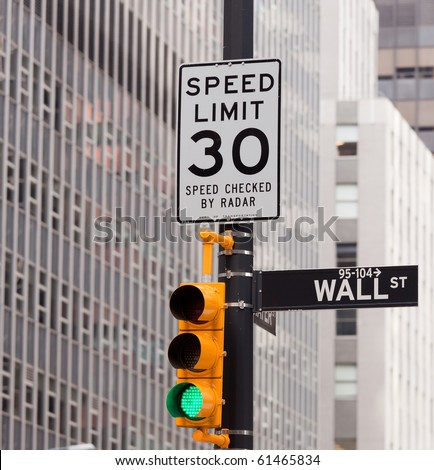 Wall Street road sign in the corner of New York Stock Exchange, Manhattan an icon of global investment, finance, trading