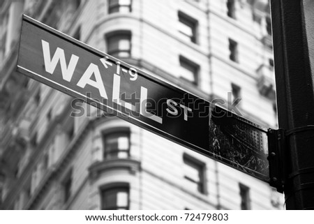Wall street sign in black and white in New York city close-up view