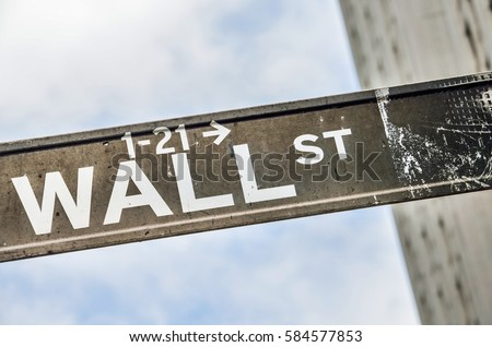 Wall street sign with sky and building in New York City #584577853