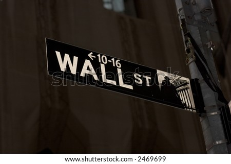 Wall Street street sign against buildings