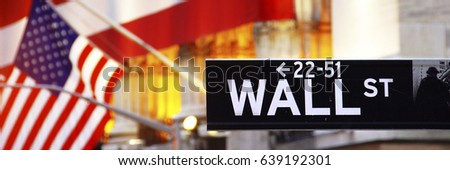 Wall Street, street sign, with US flag, in New York City #639192301