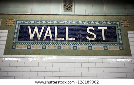 Wall street subway sign tile pattern in New York City Manhattan station.