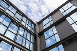 Wall structure made of steel and glass on the deck of a tall building