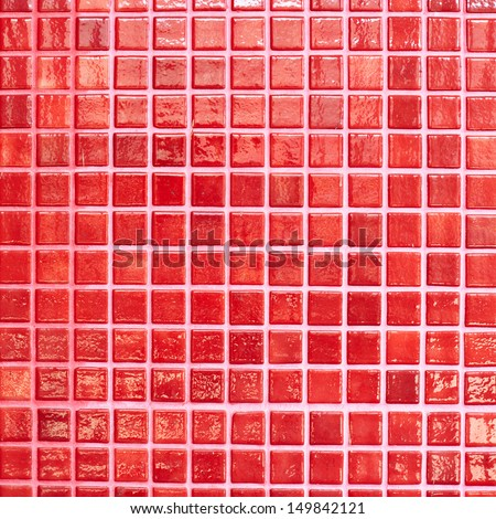 Wall tiled with red glazed tiles fragment as an abstract background