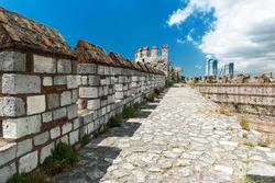 Wall top of the Yedikule Fortress, Istanbul, Turkey. Yedikule castle with the Constantinople's walls are a famous landmark of Istanbul. Ancient urban walls in summer. Remains of the Byzantine Empire.