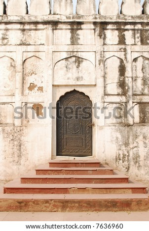 wall with arches and door and stairs in the red fort in delhi, india