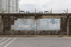 Wall with barbed wire fence