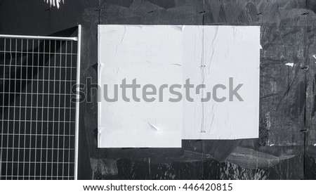 Wall with blank poster and torn posters - empty banner ready for your artwork  #446420815