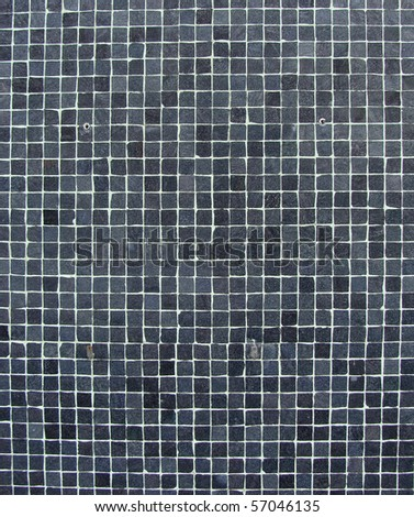 wall with blue gray black mosaic tiles