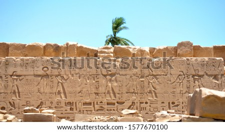 Wall with carved scripts in Karnak temple complex