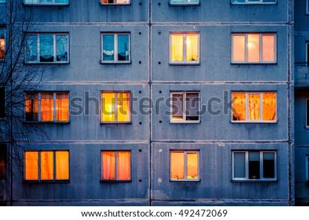 Wall with Iluminated windows. Detail of soviet era block apartment building