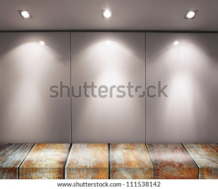 Wall with light sources and wooden floor