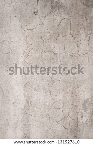 Wall with peeling plaster. Cracks in the construction putty. #131527610