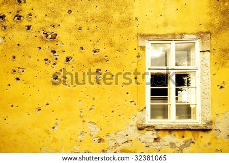 Wall with shrapnel holes