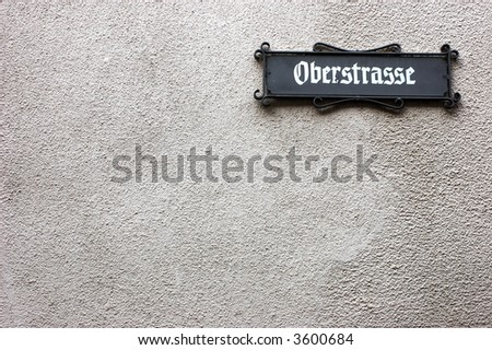 wall with street name board in a town in germany.