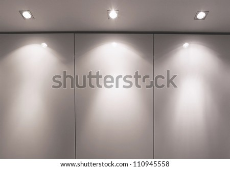 Wall with three light sources and shadow