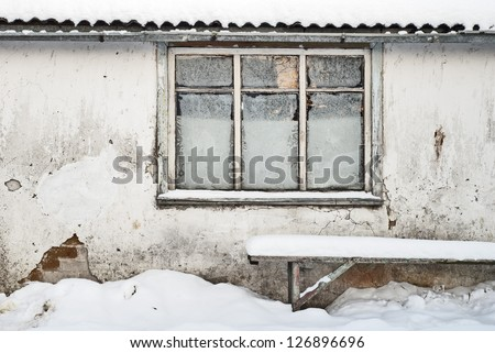 wall with window background, bench near the wall, slate roof and tin rainwater pipe