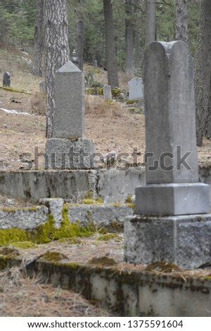 Wallace Idaho, March 29, 2019 Historic grave markers in 9 Mile Cemetery #1375591604