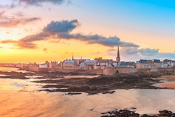 Walled city Saint-Malo with St Vincent Cathedral at sunrise at high tide. Saint-Maol is famous port city of Privateers is known as city corsaire, Brittany, France