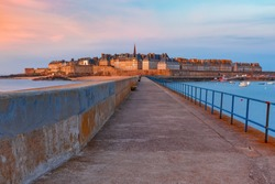 Walled city Saint-Malo with St Vincent Cathedral at sunset. Saint-Maol is famous port city of Privateers is known as city corsaire, Brittany, France