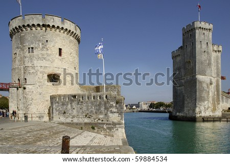 Walled entry port of La Rochelle in France,tower of the Chaine (tour de la Chaine) on the left, tower saint Nicolas (Tour saint nicolas) on the right. Region Charente Poitou