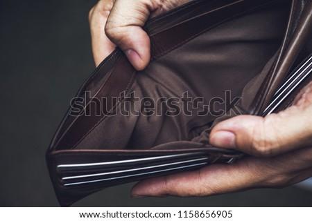 Wallet empty money broke cash ,bankruptcy economic financial , Poverty in retirement and unemployment concept.