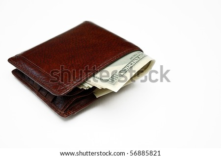 Wallet full of money. Isolated on white.