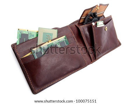 Wallet full of various computer components on a white background.