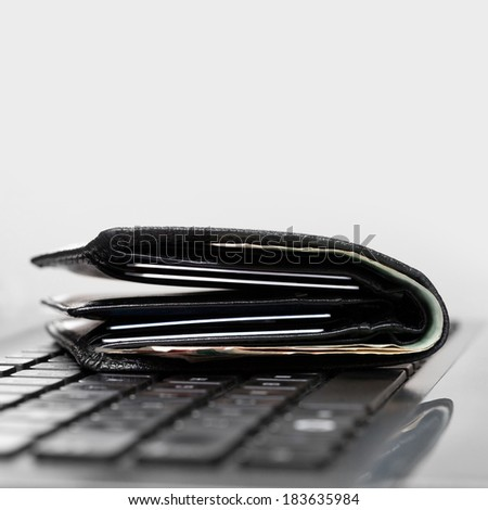 Wallet on laptop keyboard - 1 to 1 ratio