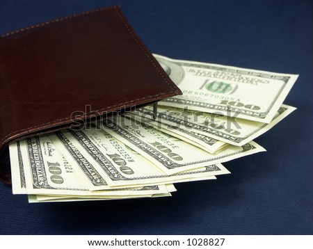 Wallet with a pile of one hundred usd dollars
