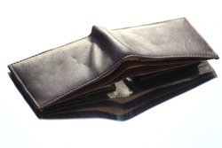 wallet with a reflection on mirror. Brown colour wallet with full open