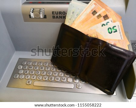 Wallet with cash drawn from ATM in bank