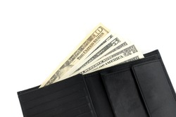 Wallet with dollar bills in front of a white background