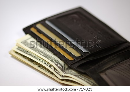 Wallet with money and credit cards. Isolated on white background.
