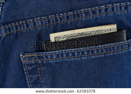 wallet with money in jeans pocket