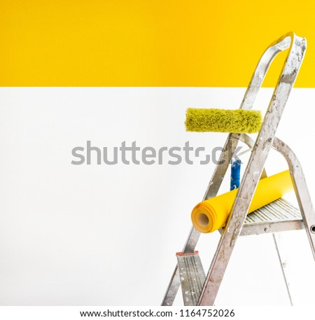 wallpaper and ladder, wallpapering  yellow color, gluing wallpapers on the wall, сoncept of repair home, instruments for a renovation #1164752026