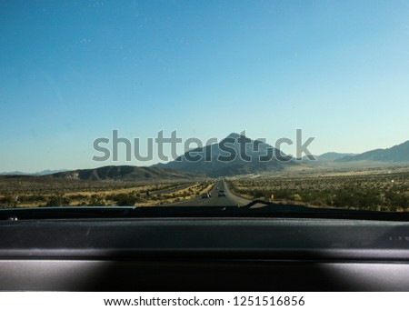 Wallpaper background landscape of Nevada desert valley from a car. Road trip photography. No people.