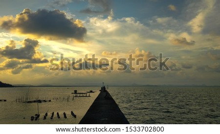 Wallpaper Pier Bridge.  The pier surrounded by the sea.  Evening atmosphere at the dam.  A long pathway with concrete floors between the sea #1533702800