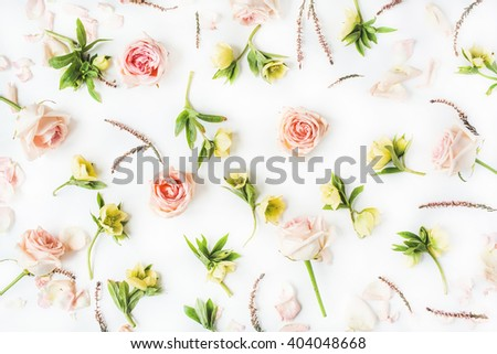 Wallpaper, texture. Pink roses and yellow flowers on white background. Flat lay, top view