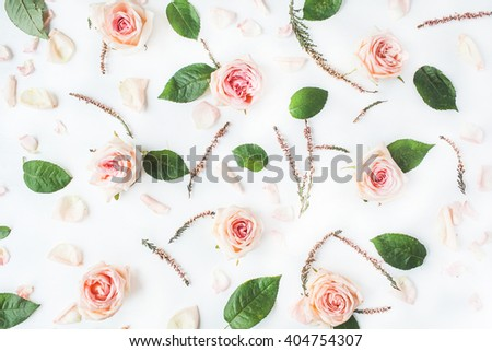 Wallpaper, texture. Pink roses on white background. Flat lay, top view