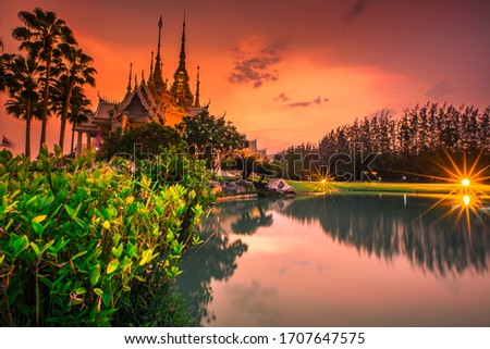 Wallpaper Wat Lan Boon Mahawihan Somdet Phra Buddhacharn(Wat Non Kum)is the beauty of the church that reflects the surface of the water,popular tourists come to make merit and take a public photo Stok fotoğraf ©