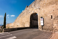 Walls and ancient gateway to the historic center of Tarquinia (Italy)