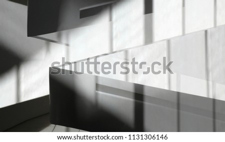 Walls and partitions with soft shadows. Collage photo of modern architecture fragments. Abstract background in chiaroscuro technique on the subject of building interior, construction or real estate.