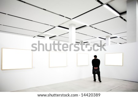walls in museum with empty frames and person looking
