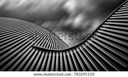 Walls of building. Motion blur sky